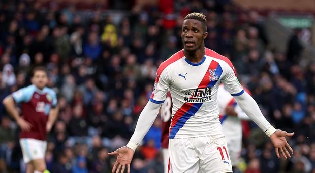 Roy Hodgson wants Crystal Palace fans to show support for Wilfried Zaha against Everton (Nigel French/PA)