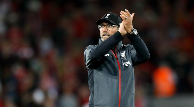 Jurgen Klopp wants his side to forget about their Champions League success and look forward (Martin Rickett/PA)