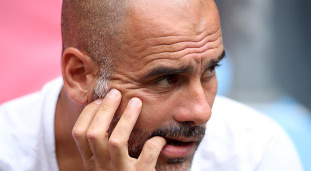 Pep Guardiola was not totally convinced by City's performance in London (Adam Davy/PA)