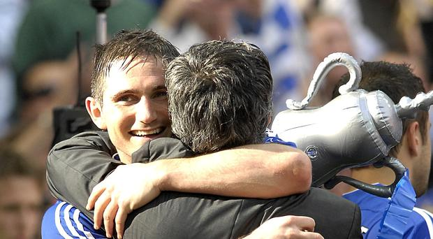 Chelsea manager Jose Mourinho and Frank Lampard celebrate after winning the FA Cup