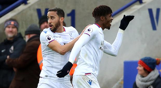 "Andros Townsend (left) believes Crystal Palace are ""lucky"" to still have Wilfried Zaha (right) (Nigel French/PA)"