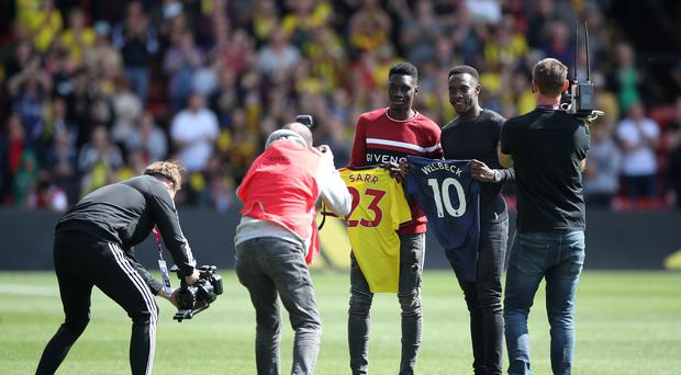 Ismaila Sarr, left, and Danny Welbeck were introduced to the Watford fans last week (Nick Potts/PA)