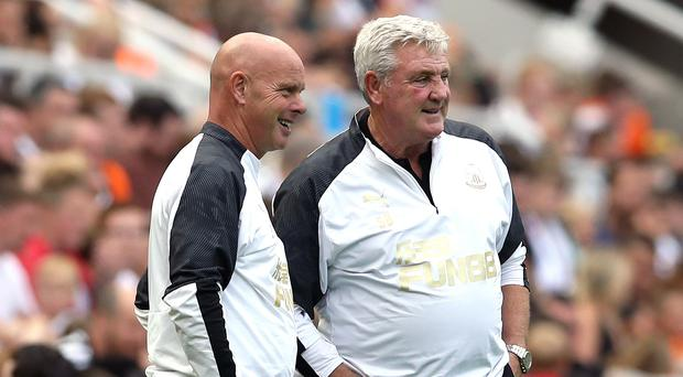 Newcastle head coach Steve Bruce (right) takes his team to former club Norwich on Saturday (Owen Humphreys/PA)