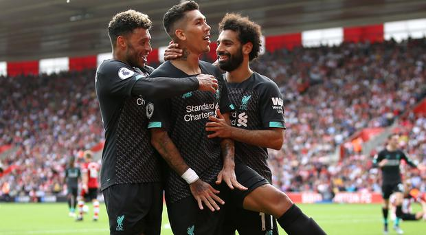 Liverpool made it 11 Premier League wins in a row with a 2-0 success at Southampton (Steven Paston/PA)