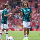 David Luiz, right, in the warm-up ahead of the match against Burnley (Yui Mok/PA)
