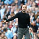Pep Guardiola has praised the performances of his side (Martin Rickett/PA).