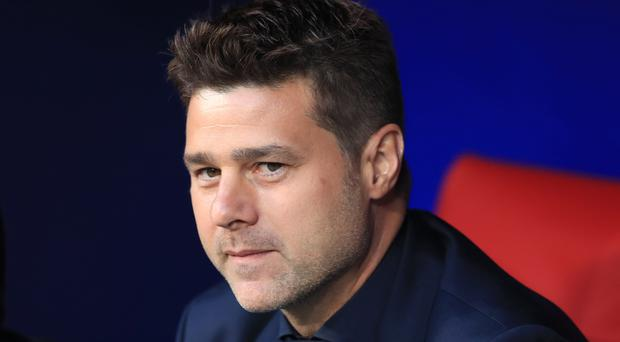 Spurs boss Mauricio Pochettino would like to see changes to the transfer window (Mike Egerton/PA)