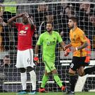 Manchester United's Paul Pogba reacts after seeing his penalty saved by Rui Patricio (PA)