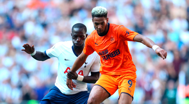Under control: Newcastle ace Joelinton shields the ball from Moussa Sissoko of Spurs at the Tottenham Hotspur Stadium