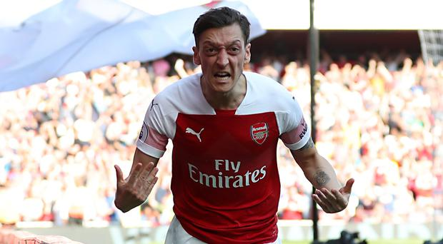 Unai Emery wants to keep Mesut Ozil, pictured, at Arsenal (Bradley Collyer/PA)