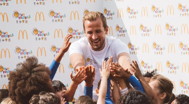 Tottenham striker Harry Kane was working at McDonald's Football Fun Session (PA)