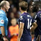 West Ham's Arthur Masuaku (right) speaks to referee Mike Dean after being sent off against Aston Villa (Martin Rickett/PA).