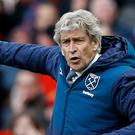 Manuel Pellegrini's West Ham take on Manchester United on Sunday (Martin Rickett/PA)