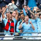 Manchester City lift the FA Cup after beating Watford 6-0 at Wembley in May (Nick Potts/PA)