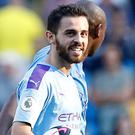 Bernardo Silva scored a hat-trick as Manchester City thrashed Watford (Martin Rickett/PA)