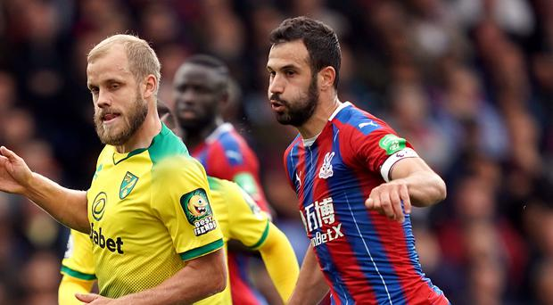 Luka Milivojevic (right) scored his first goal of the season to help Crystal Palace defeat Norwich 2-0 at Selhurst Park (John Walton/PA).