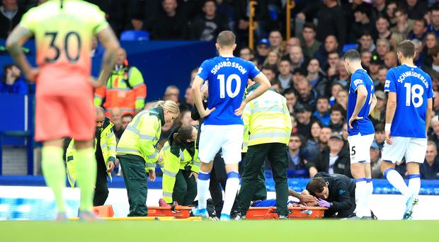 Everton's Theo Walcott is stretched off after an injury during the Premier League match at Goodison Park, Liverpool.