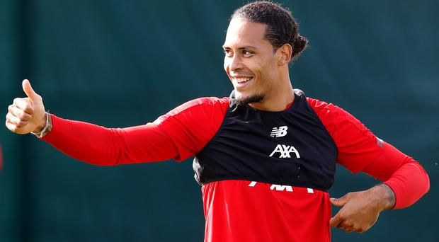 Liverpool's Virgil Van Dijk insists there is no need to panic after a scare at home to Red Bull Salzburg (Martin Rickett/PA)