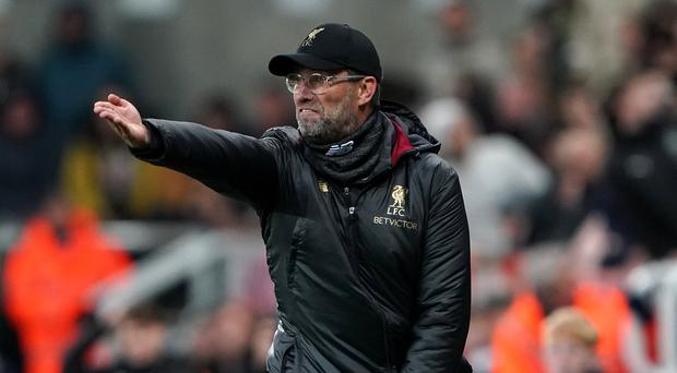 Jurgen Klopp admits he would quit Liverpool if the club signed up for a fly-on-the-wall documentary (Owen Humphreys/PA)