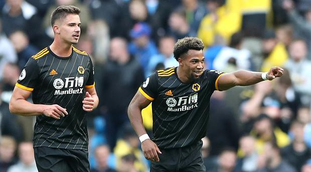 Adama Traore (right) produced a late double to stun City (Nick Potts/PA)