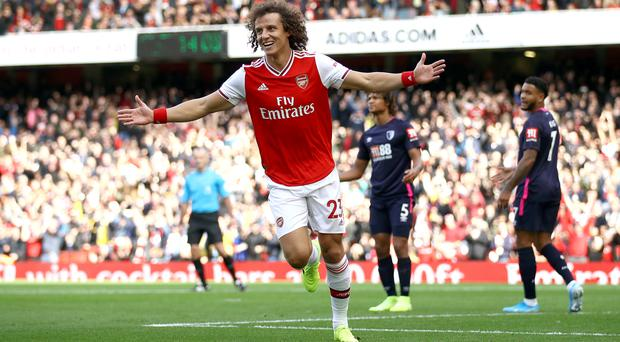 Arsenal's David Luiz celebrates scoring his sides first goal of the game during the Premier League match at the Emirates Stadium, London.
