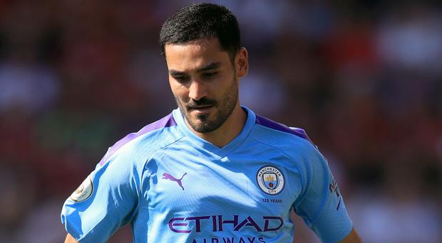 Ilkay Gundogan is concerned Manchester City could fall further behind Liverpool (Adam Davy/PA)