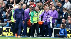 Hugo Lloris was carried off on a stretcher after dislocating in elbow in Tottenham's defeat at Brighton (Gareth Fuller/PA)