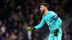Hugo Lloris was taken off on a stretcher after dislocating his elbow in Tottenham's loss at Brighton. (Steven Paston/PA)