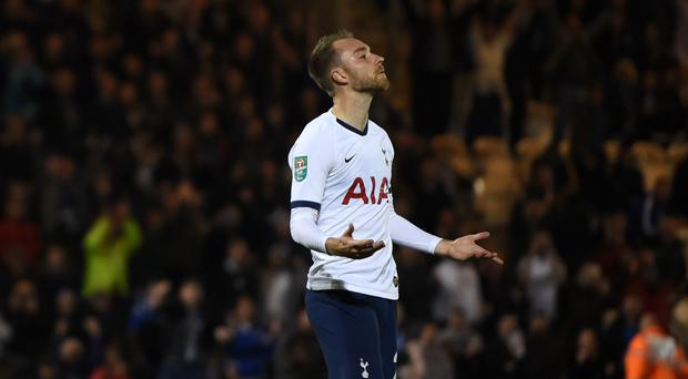 Tottenham Hotspur's Christian Eriksen reacts after missing a penalty during the Carabao Cup, Third Round match at the JobServe Community Stadium, Colchester.