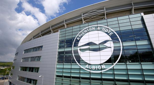 Three Brighton fans are facing a lengthy ban for racist abuse (Gareth Fuller/PA)