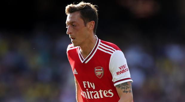 Mesut Ozil's Arsenal career is up in the air (Nick Potts/PA)