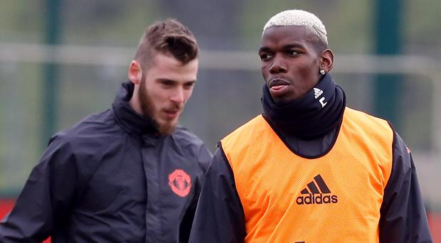 Paul Pogba, right, and David De Gea have been at the centre of pre-match speculation (Martin Rickett/PA)