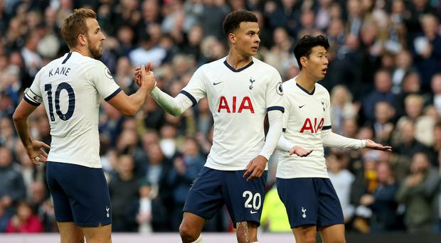 Tottenham's Dele Alli, centre, celebrates with team-mate Harry Kane after scoring the equaliser against Watford (Jonathan Brady/PA)