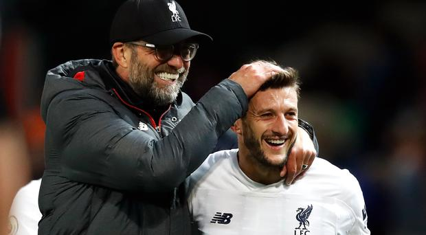 Adam Lallana, right, rescued Liverpool at Old Trafford (Martin Rickett/PA)