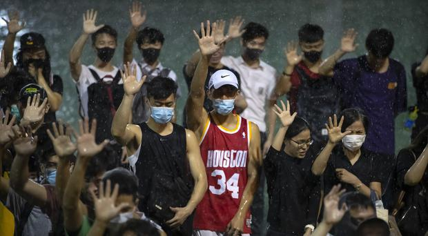 China's treatment of pro-democracy protesters in Hong Kong has been criticised (Mark Schiefelbein/AP)
