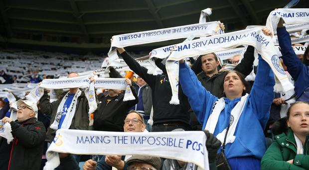 Leicester City fans lift their scarves in memory of former chairman Vichai Srivaddhanaprabha (Nigel French/PA)