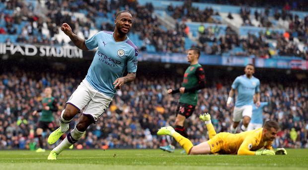 Manchester City's Raheem Sterling celebrates scoring his side's first goal (Martin Rickett, PA)