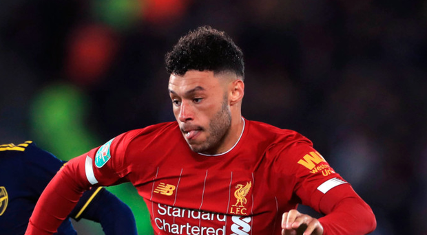 On the ball: Alex Oxlade-Chamberlain strides ahead against Arsenal
