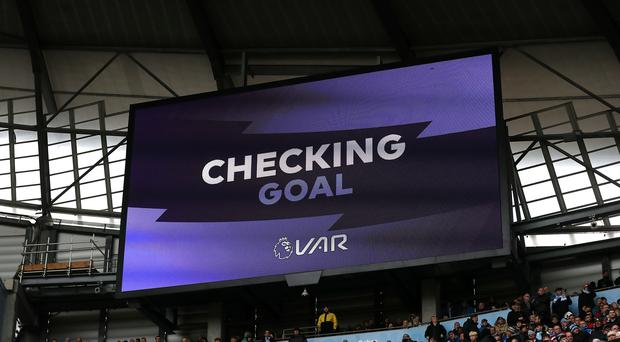 A VAR decision is displayed on the big screen at the Etihad Stadium, Manchester (PA).