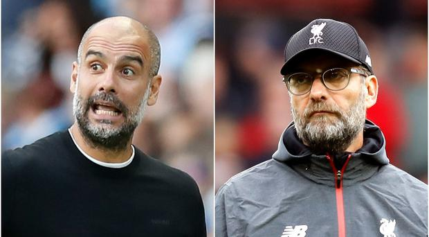 Klopp (right) insists he does not want to talk about Manchester City (Martin Rickett/PA)