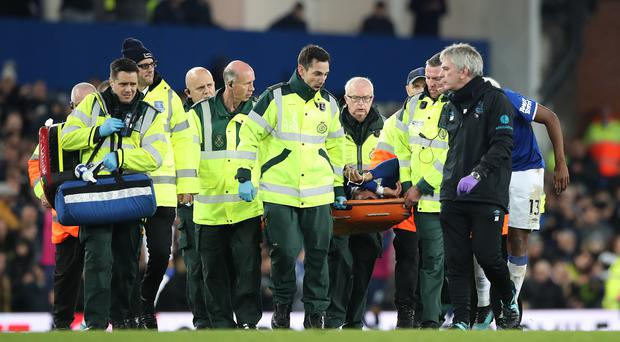 Everton's Andre Gomes is carried off the field after suffering a fractured dislocation of his ankle against Tottenham (Nick Potts/PA)