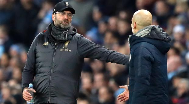 Jurgen Klopp has said he respects the Manchester City side managed by Pep Guardiola (Martin Rickett/PA)