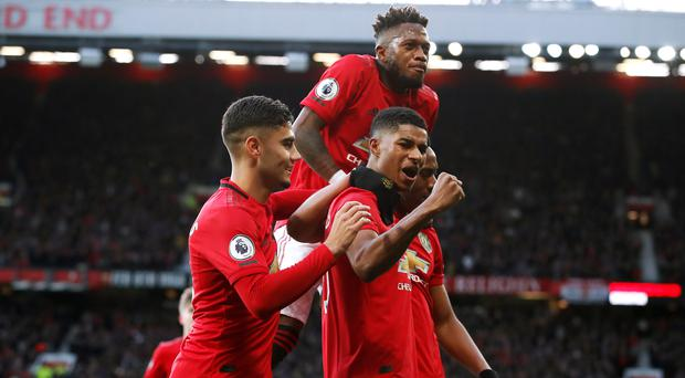 Manchester United eased to victory at home to Brighton (Martin Rickett/PA)