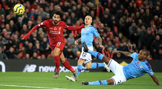 Mohamed Salah, left, heads home Liverpool's second goal against Manchester City at Anfield (Peter Byrne/PA)