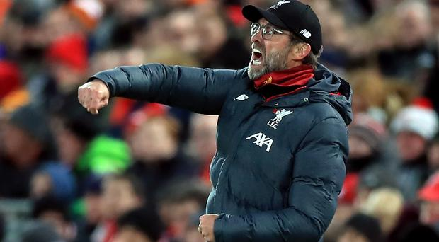 Liverpool manager Jurgen Klopp has overseen a remarkable season for the Reds so far (Peter Byrne/PA)