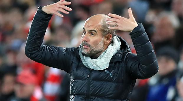 Pep Guardiola was left furious by the VAR decisions at Anfield (Peter Byrne/PA)