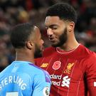 Liverpool's Joe Gomez (right) and Manchester City's Raheem Sterling clash during the Premier League match at Anfield, Liverpool (Peter Byrne/PA)