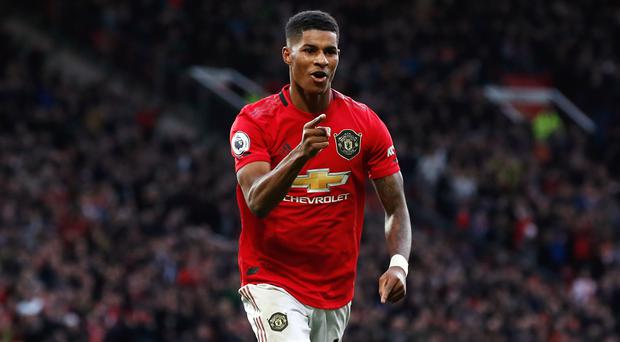 Marcus Rashford believes Manchester United's high standards help him cope with pressure (Martin Rickett/PA)
