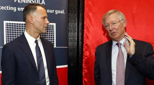 Sir Alex Ferguson sends his former Manchester United player Ryan Giggs a good luck message before every Wales game (Martin Rickett/PA)