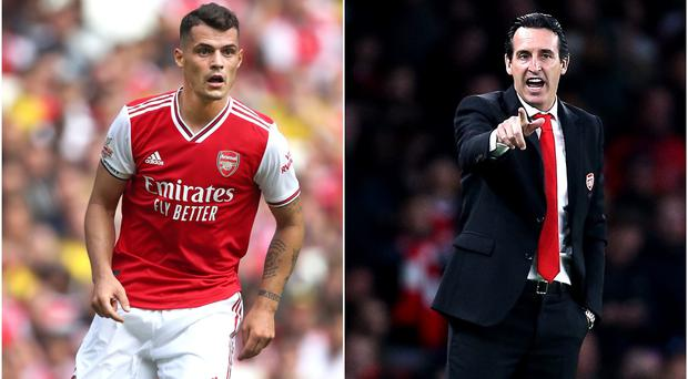 Could Granit Xhaka, left, be brought in from the cold by Unai Emery? (Nick Potts/Nigel French/PA)